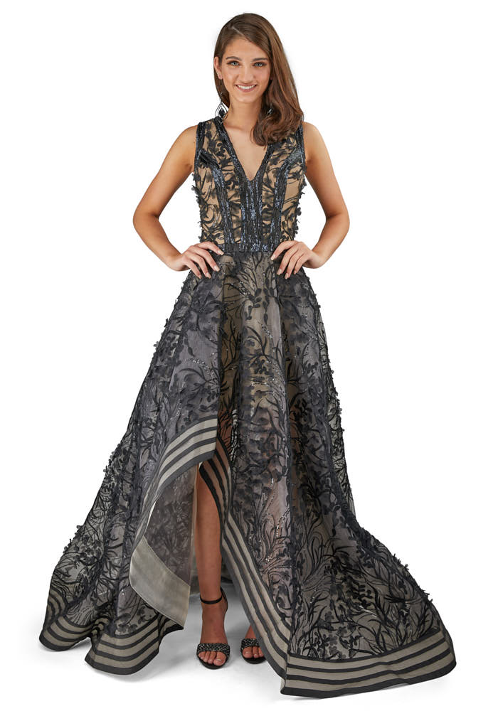 model front side on a black prom dress. dresses photoshoot in studio