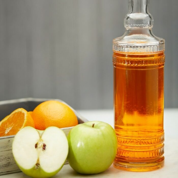 Glass Bottle for Apple Juice Photo with oranges and apples