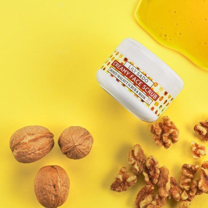 cosmetics product shot on yellow background with walnuts and honey