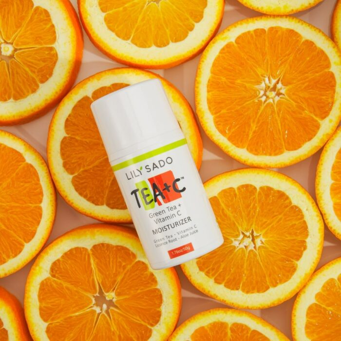 cosmetics product shot with oranges
