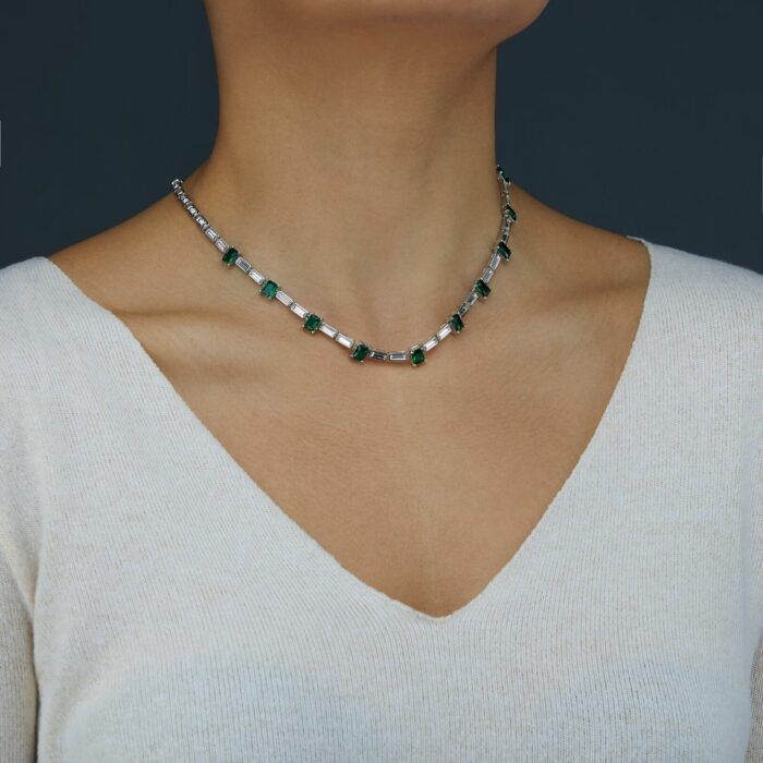Silver Necklace Photoshoot on a model on a grey background for eCommerce listing