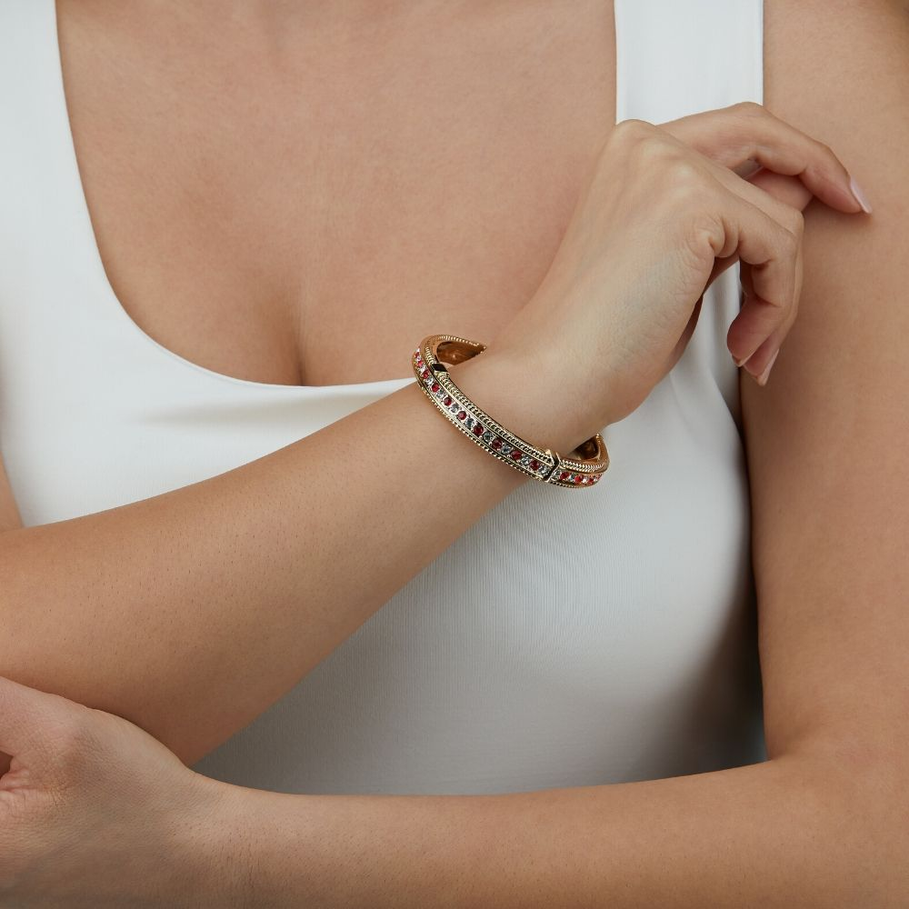 Gold and Red Bracelet Photoshoot on a model