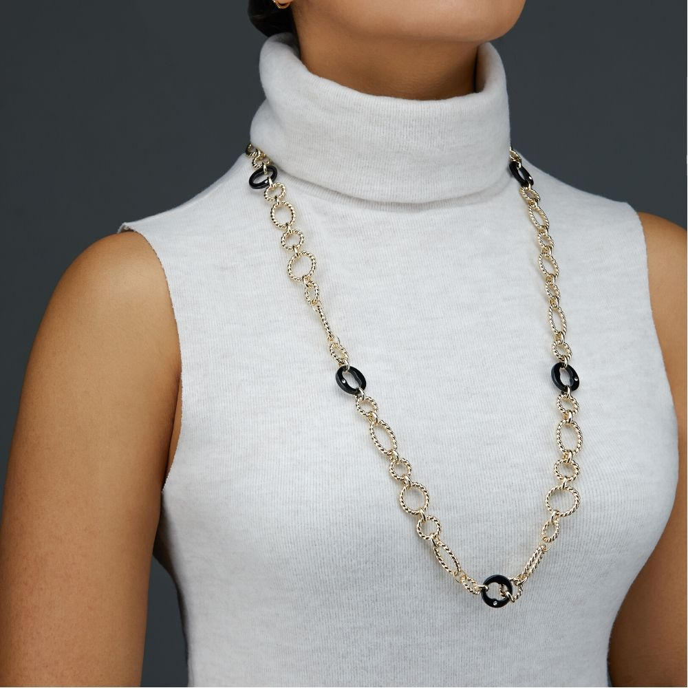Long Necklace Photoshoot on a model on a grey background for eCommerce listing