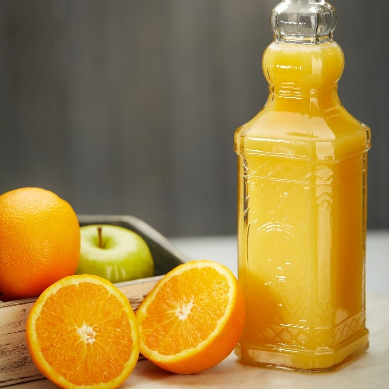 Glass Bottle of Orange Juice Photoshoot in a kitchen setup