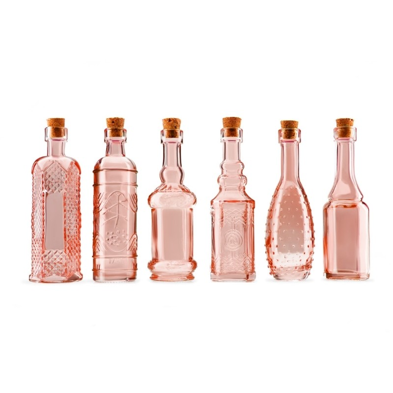 Group of 6 Pink Glass Bottles on a white background