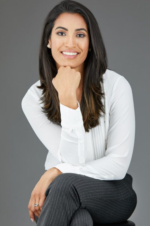 Corporate Headshot of beautiful young lady on grey background