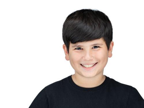 Professional Headshot of kid model on white background