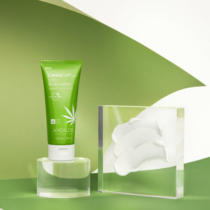 Beauty lotion product shot on a green paper showing texture of the product